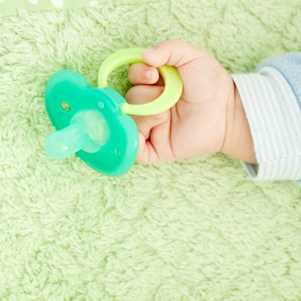 Place the Pacifier In the Baby's Mouth